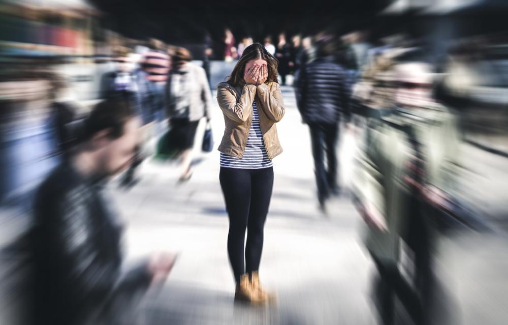 Woman feeling stressed in public