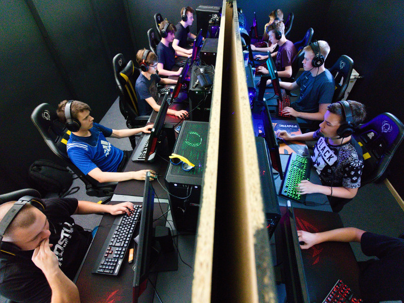 Rows of e-sports players at a tournament.