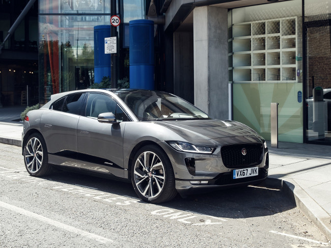 silver grey Jaguar electric vehicle parked on a street.