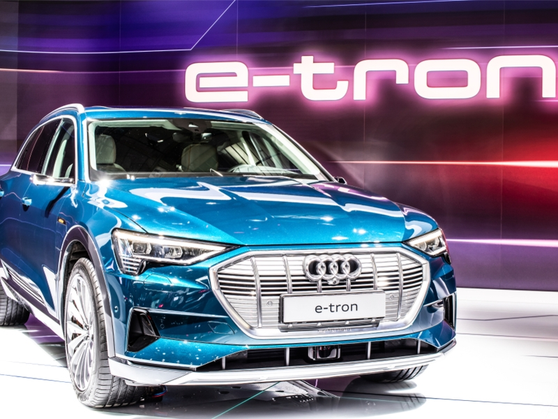 Blue Audi vehicle at trade show.