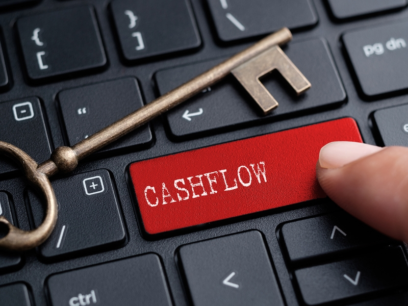 Picture of a key beside a keyboard button saying 'cashflow'