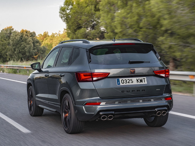 Rear view of Cupra Ateca driving on a road.
