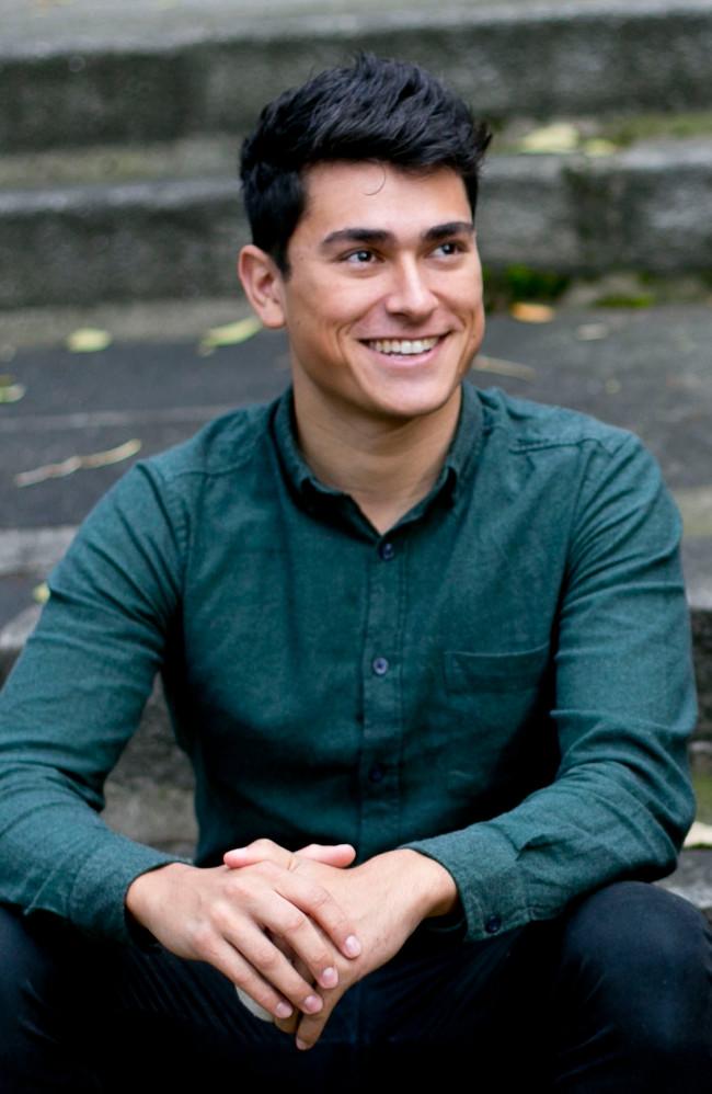 Dark-haired man in blue shirt.