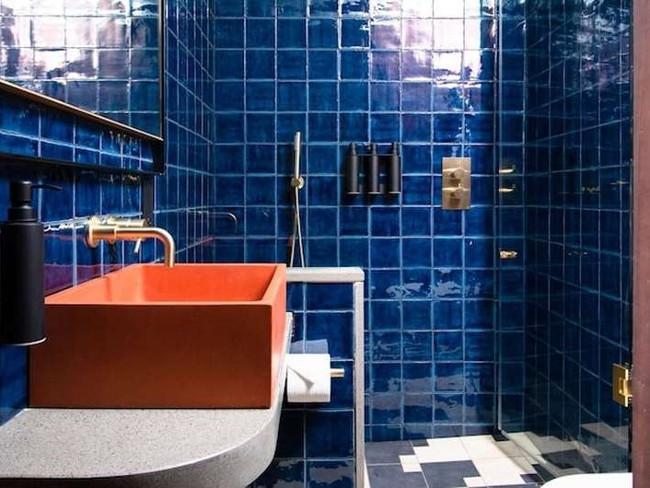 A square Mayson sink coloured orange.