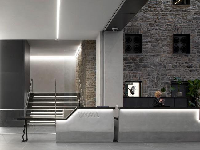 Concrete reception desk in building.
