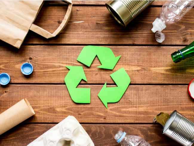 recycling symbol surrounded by waste.