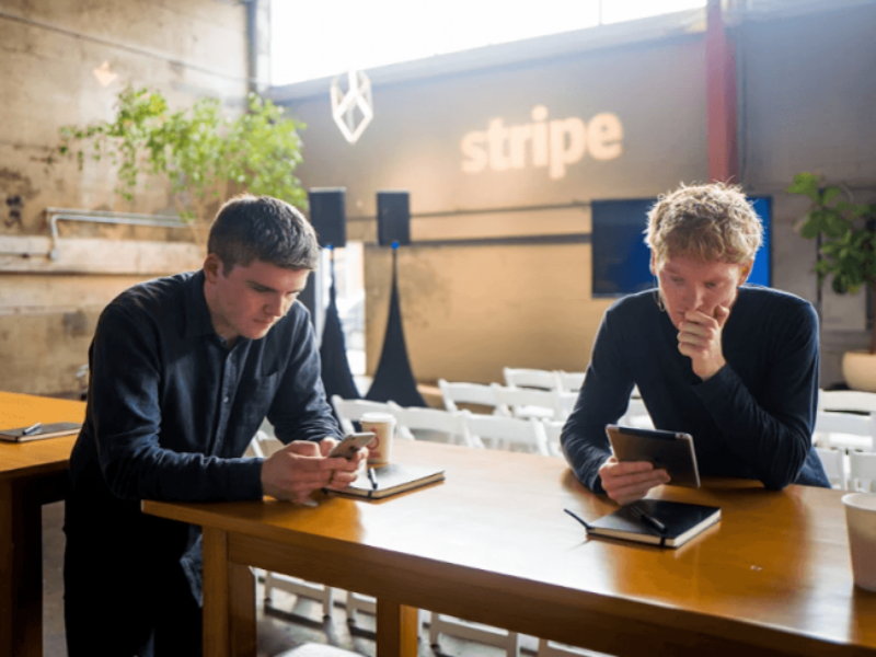 Two young men looking at phones.