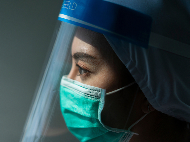 doctor wearing a face shield and mask.