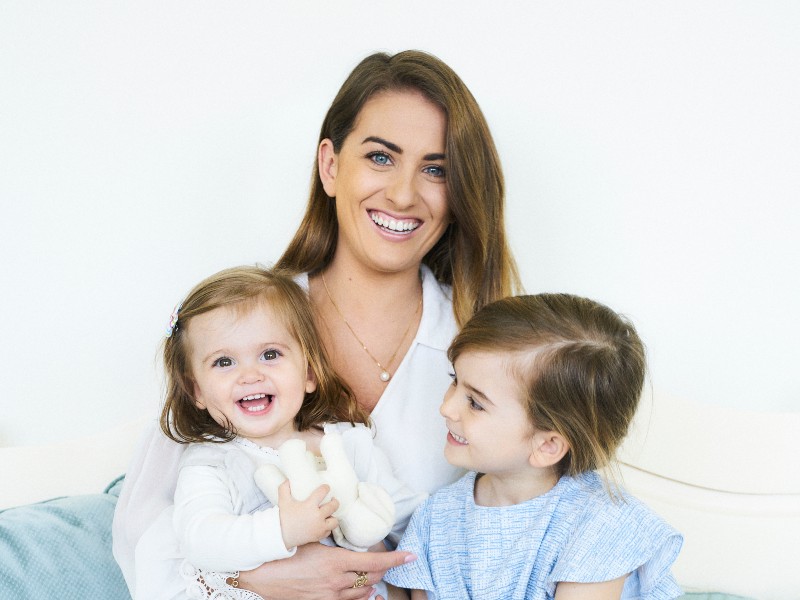 Dark-haired woman with her two children.