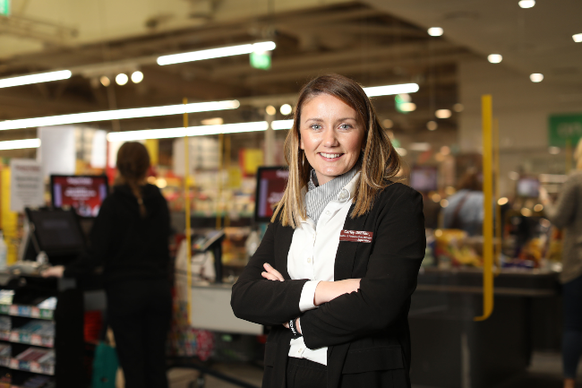 Woman retail worker in SuperValu Blackrock.