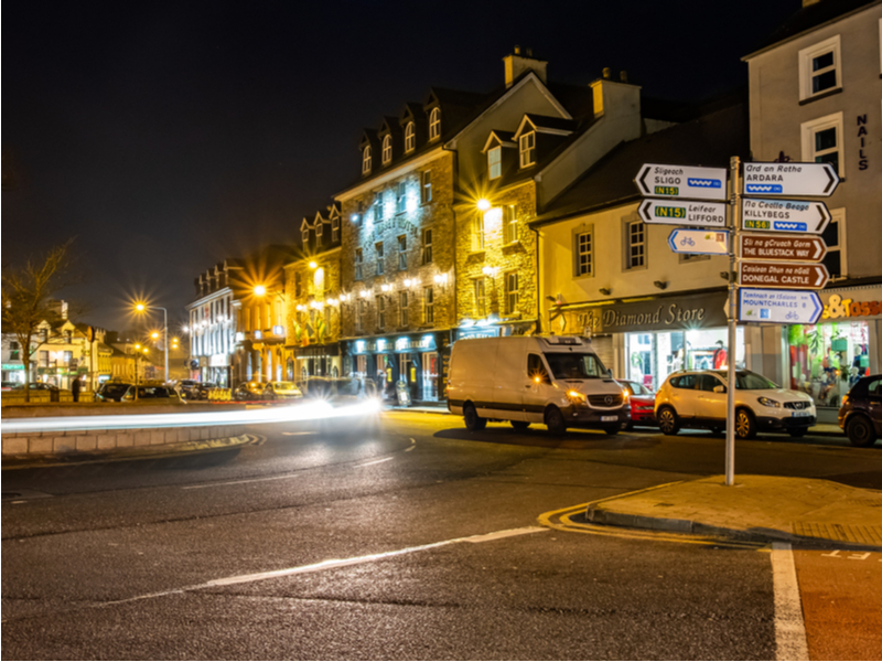 Donegal town at night with lights blurred.