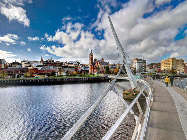 view from bridge leading into city of Derry.