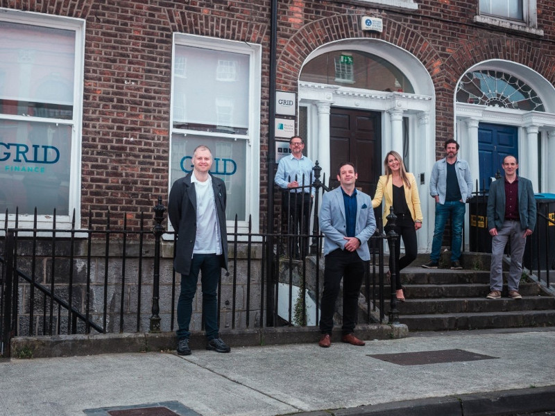 Group of people standing on steps of a building in Limerick.