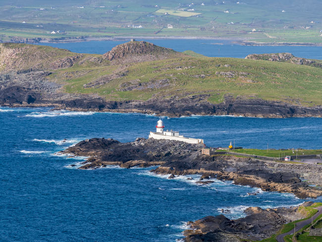 Lighthouse along rugged coastline in Valentia, Kerry.