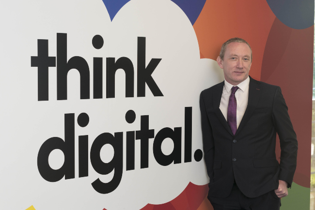 Man in suit beside words Think Digital.