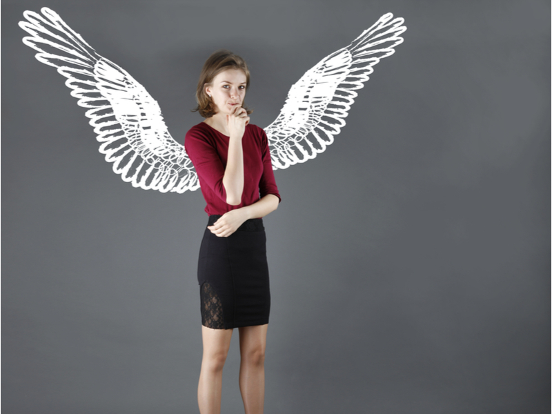 business woman with angel wings behind her to denote angel investing.