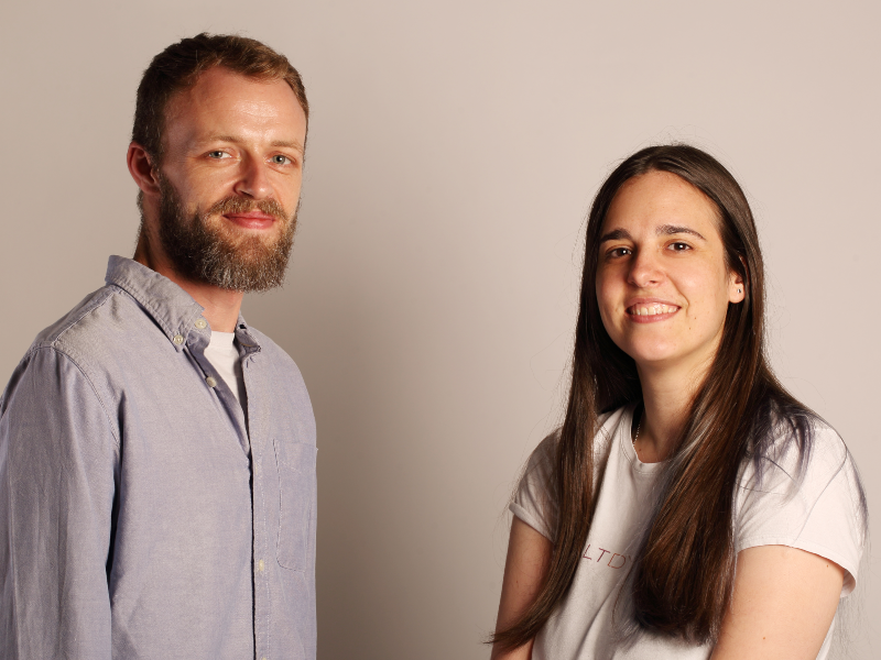 Man with beard beside dark-haired woman.