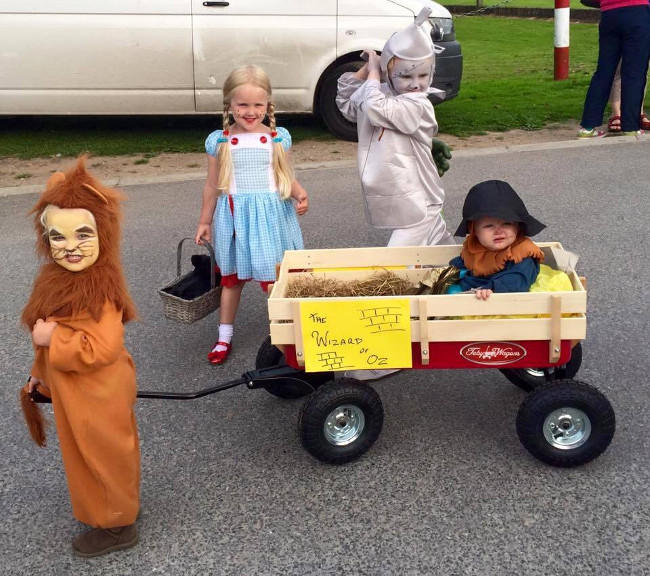 kids playing with a wagon.