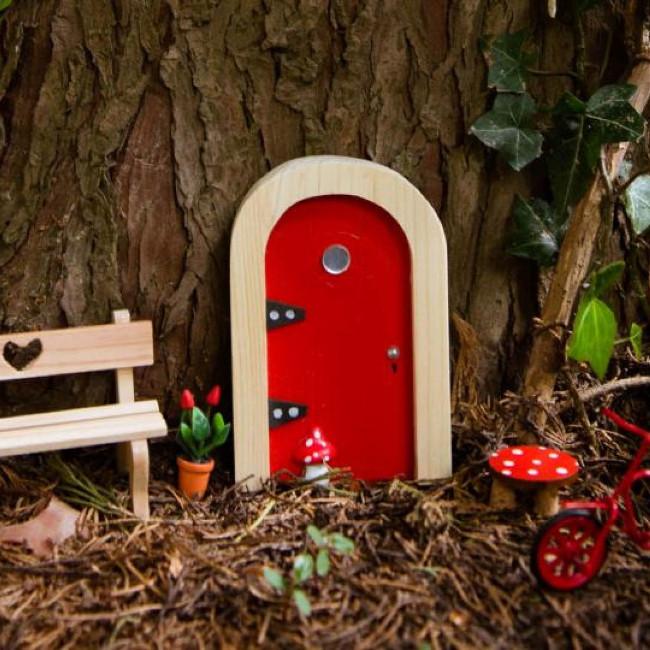 Fairy door in tree.