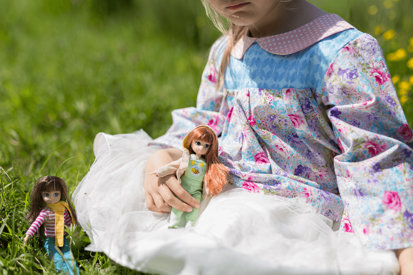girl playing with dolls.