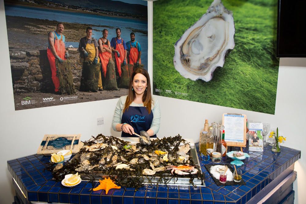 Woman shucking oysters.