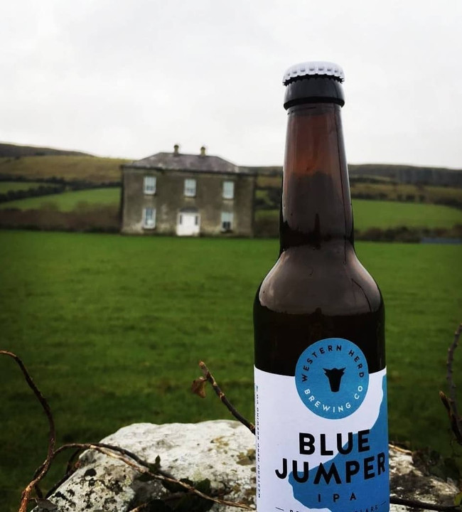 Beer bottled named Blue Jumper on a wall outside Father Ted's famous house on Craggy Island.