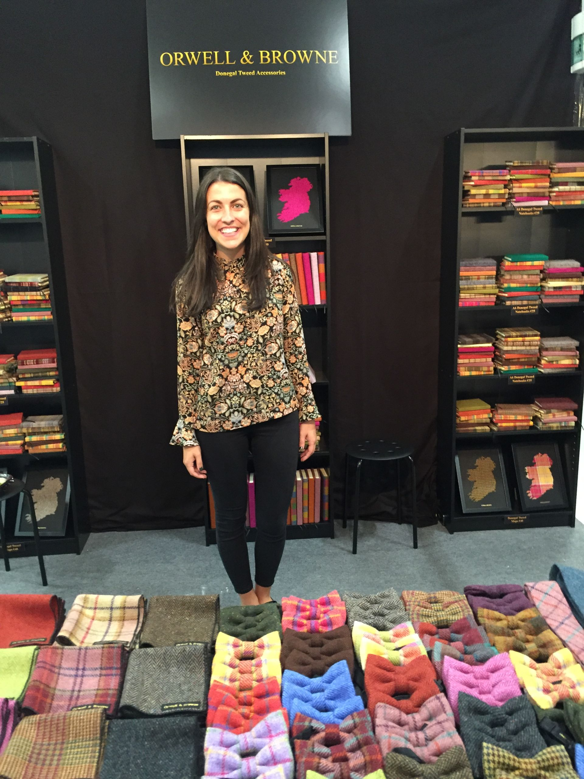 Woman standing in a clothes shop.
