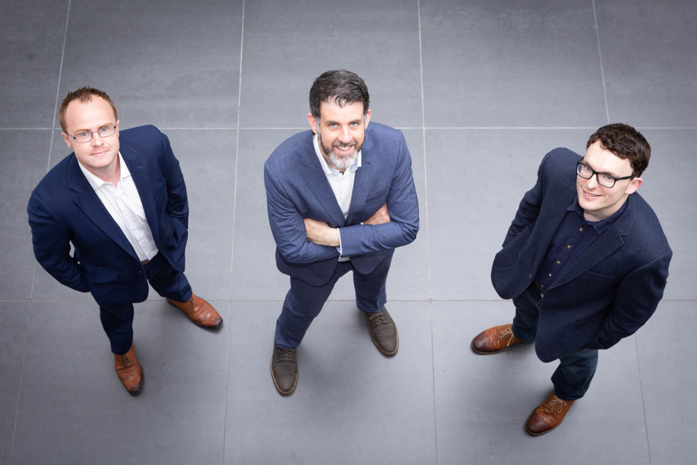 Three smart dressed men.