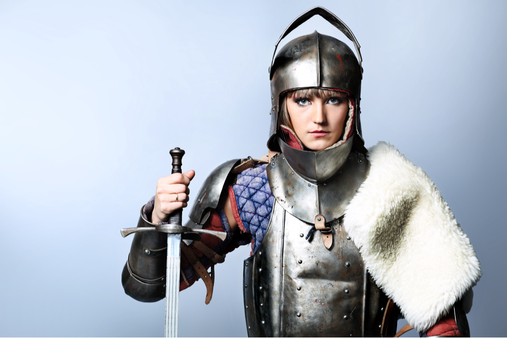 Woman in armour with a sword.