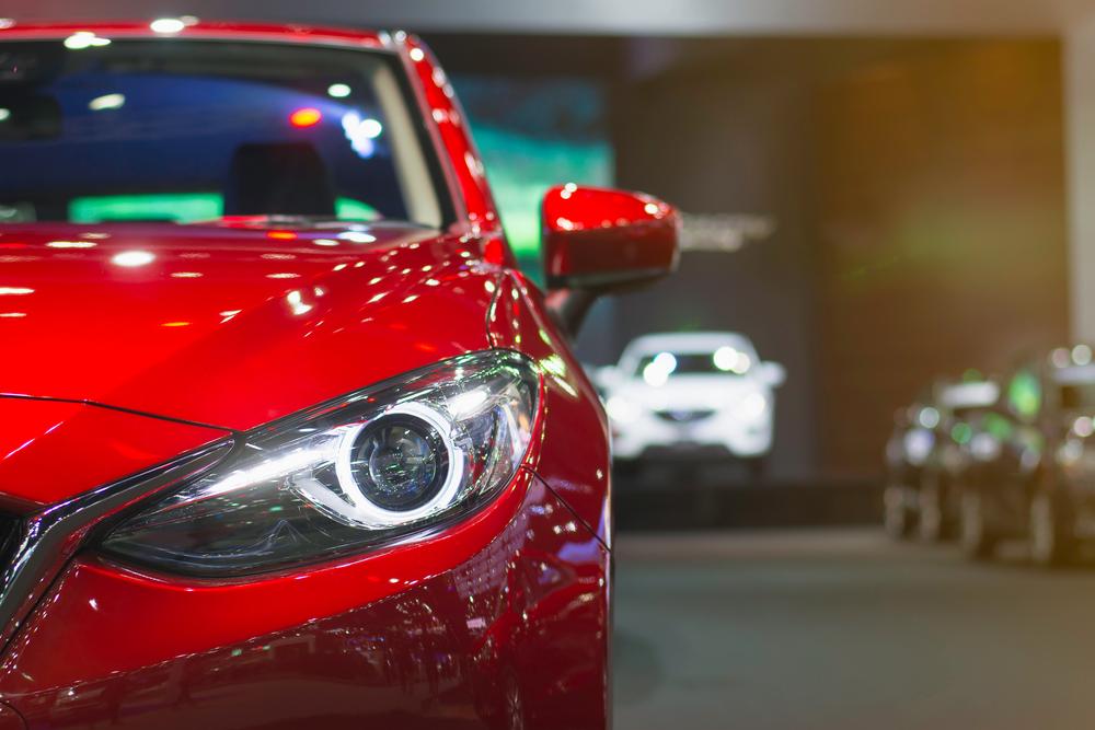 shiny new red car.