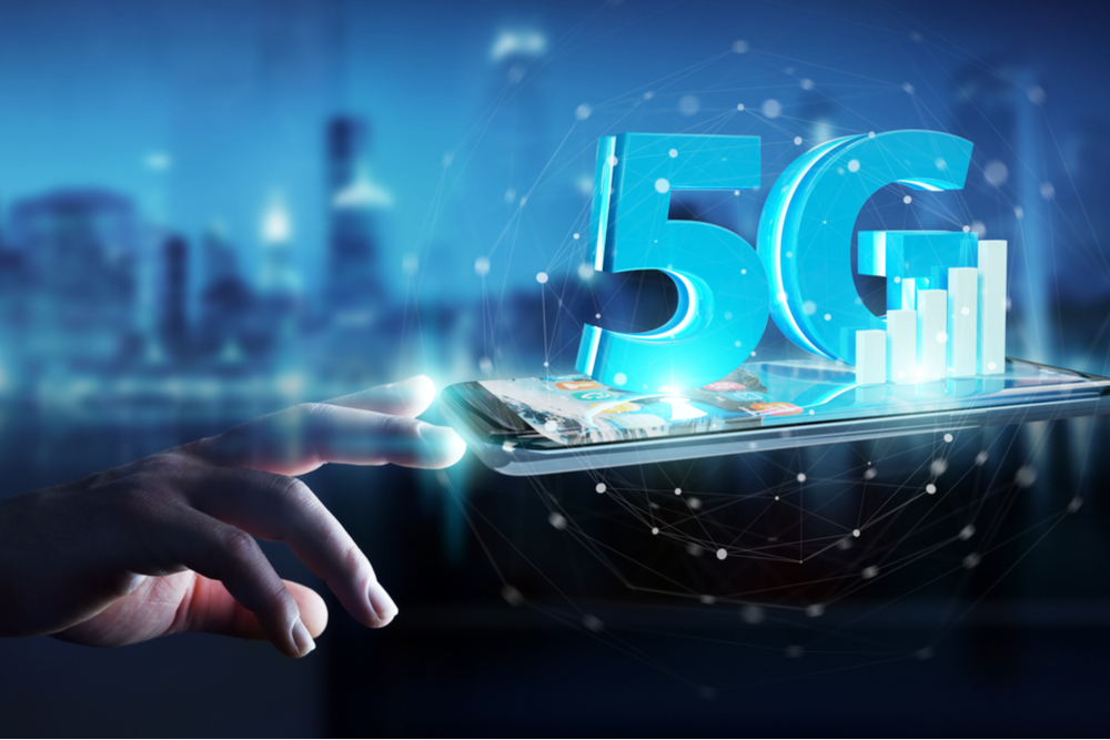 Hand touching a 5G smartphone.