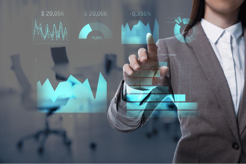 female financial professional using data.