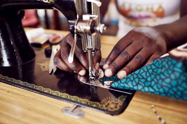Hands at sewing machine.
