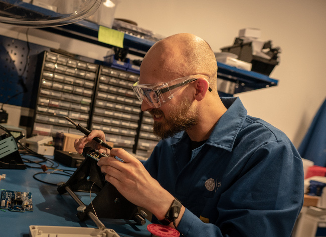 Man working with electronics.