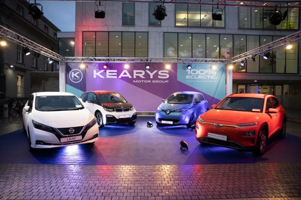 Electric car fleet at forecourt of car dealership.