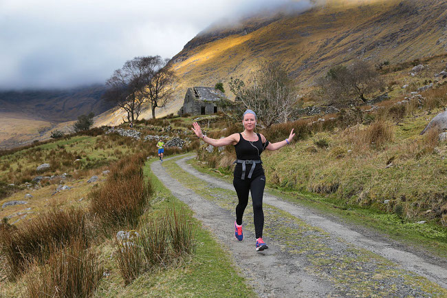 Woman running in Kerry.