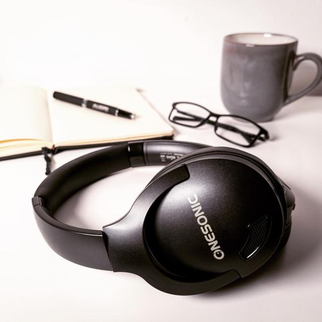 OneSonic headphones on a desk.