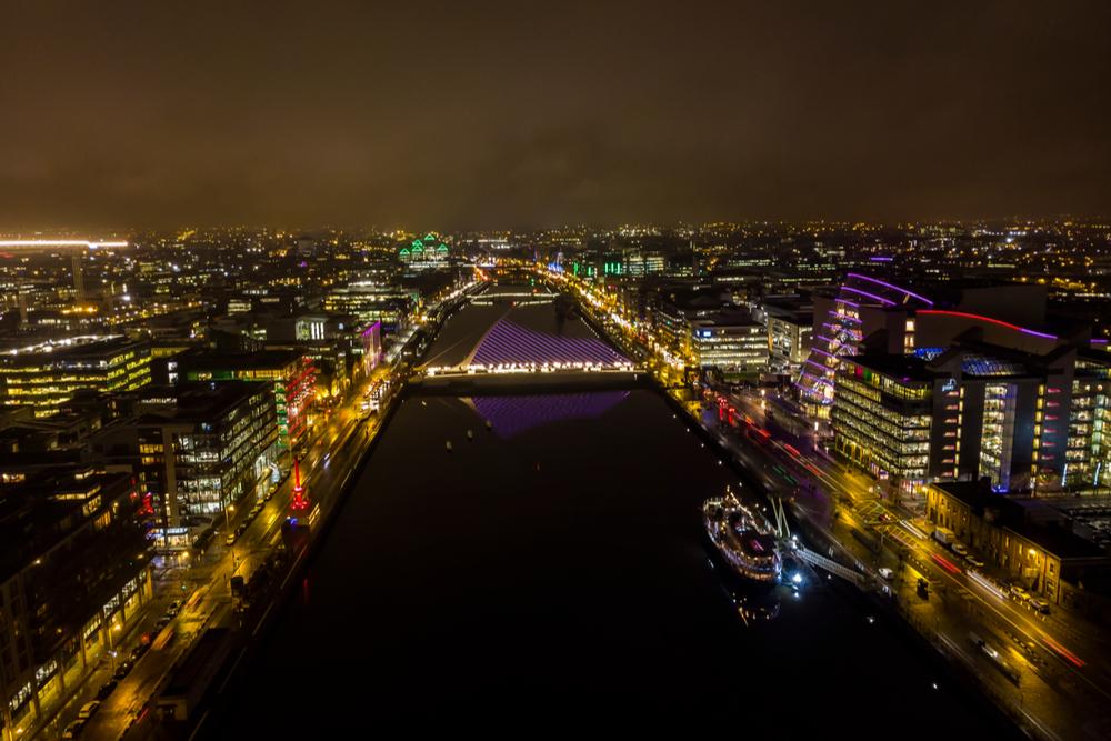 Dublin city lit up at night.