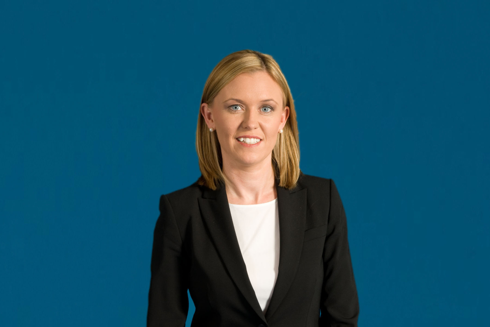 Blonde-haired woman in business suit.