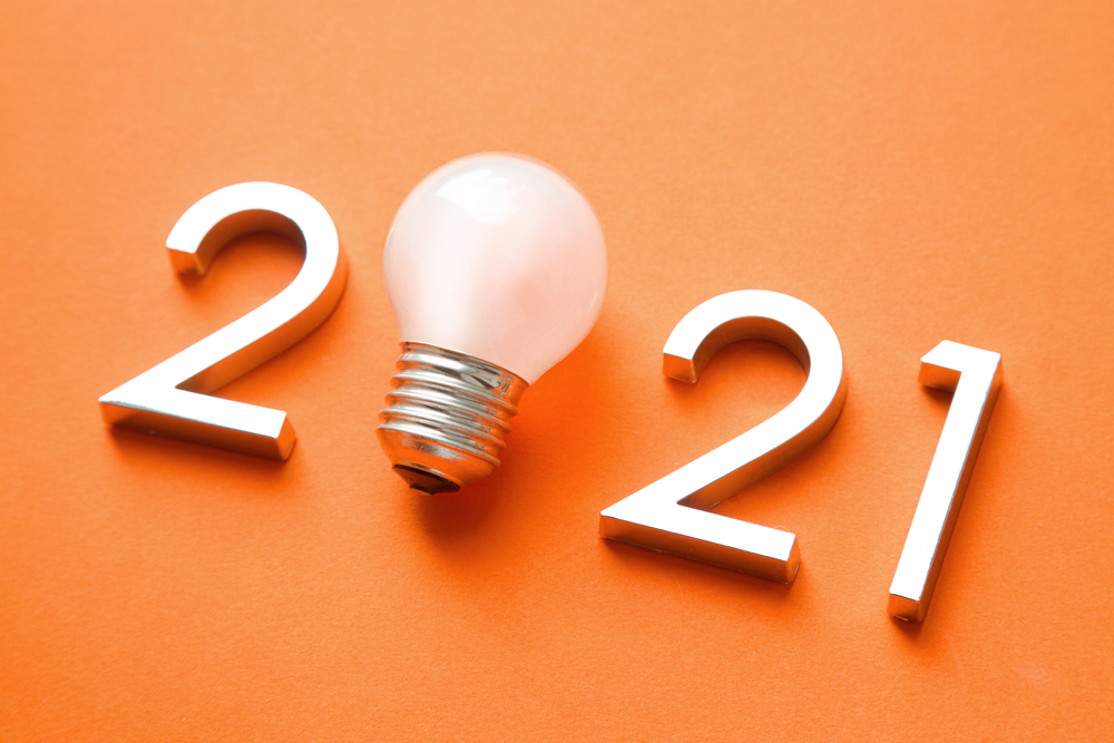 2021 with a light bulb on a coral background.