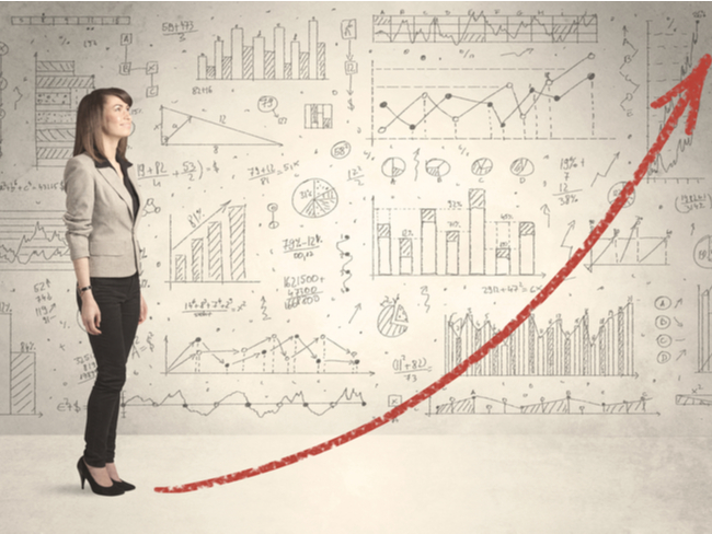 Woman standing in front of a scale-up curve.