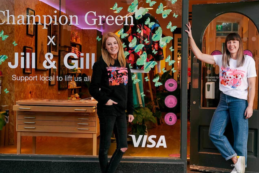 Two young women outside a design studio shop.
