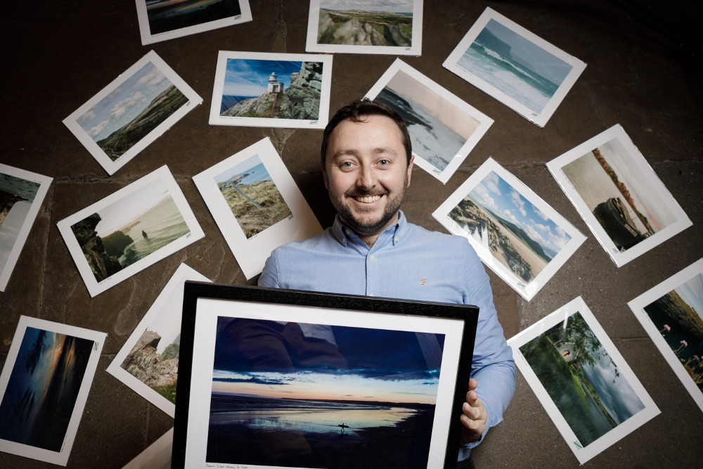 Man surrounded by photographs.