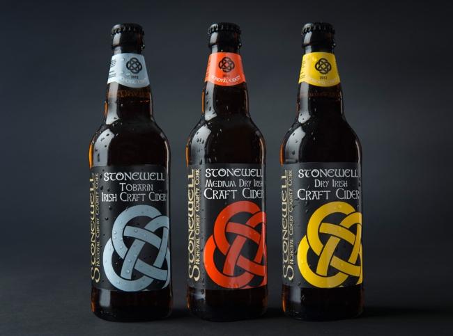 Three bottles of Stonewell cider.