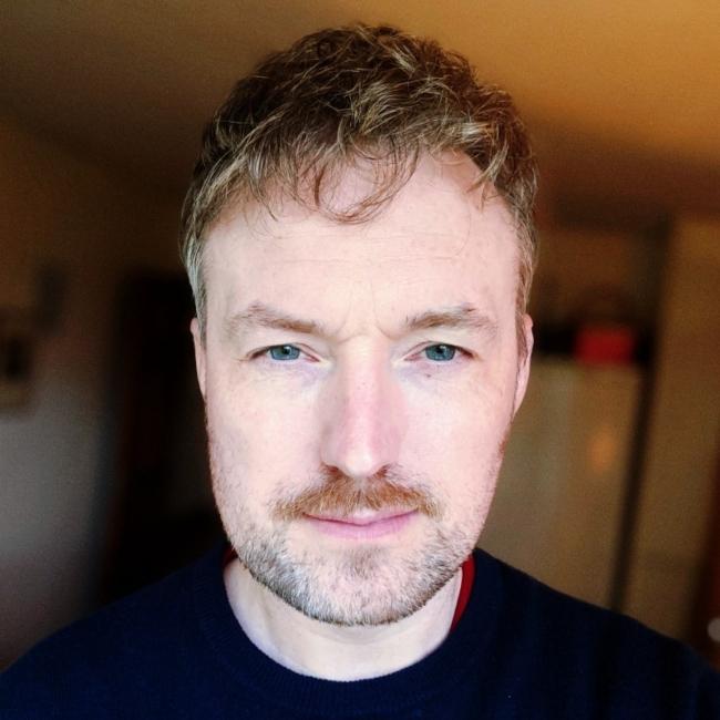 Fair-haired man in black t-shirt.