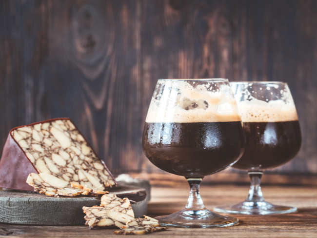 Two glasses of dark beer with Irish Porter Cheddar.