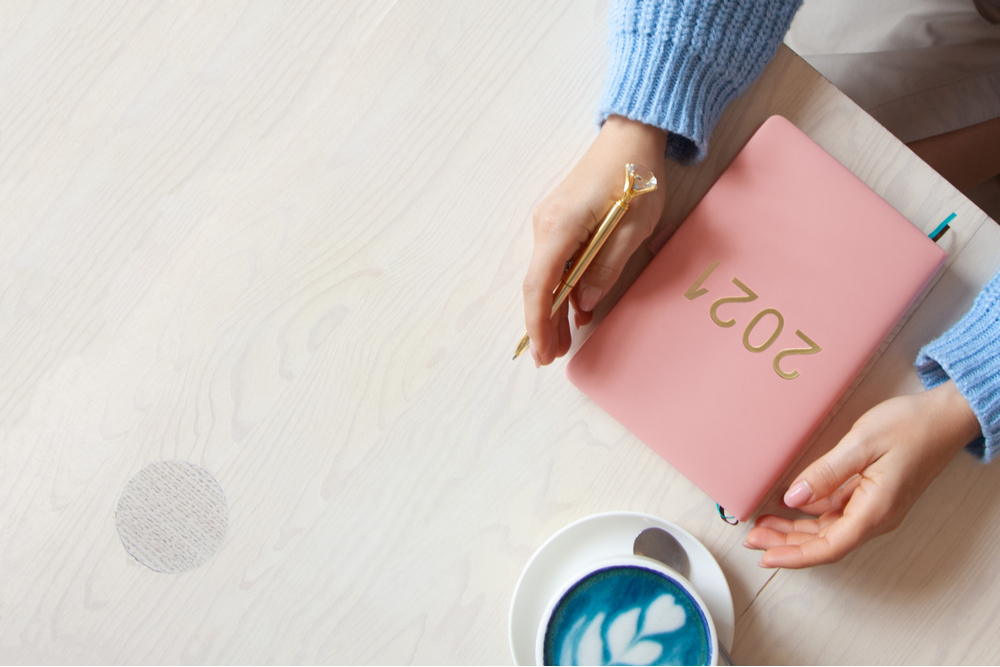 Woman holding 2021 diary.