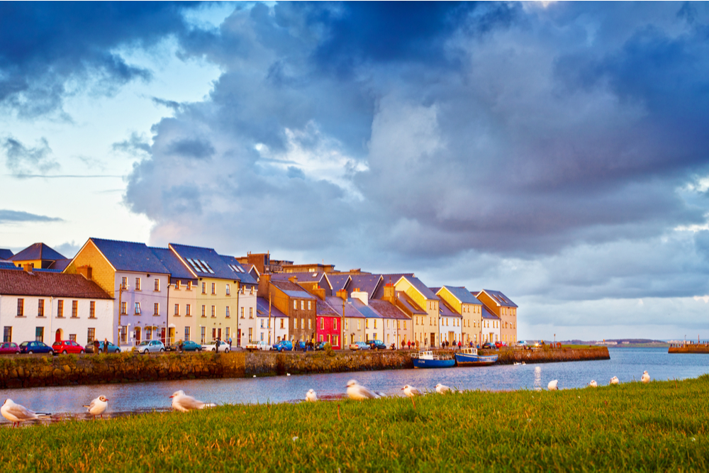 Colourful houses in Galway beside the sea.