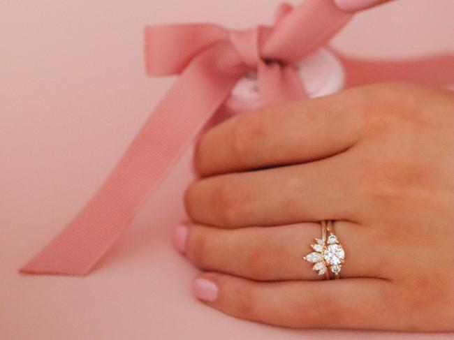 Woman wearing a diamond ring.