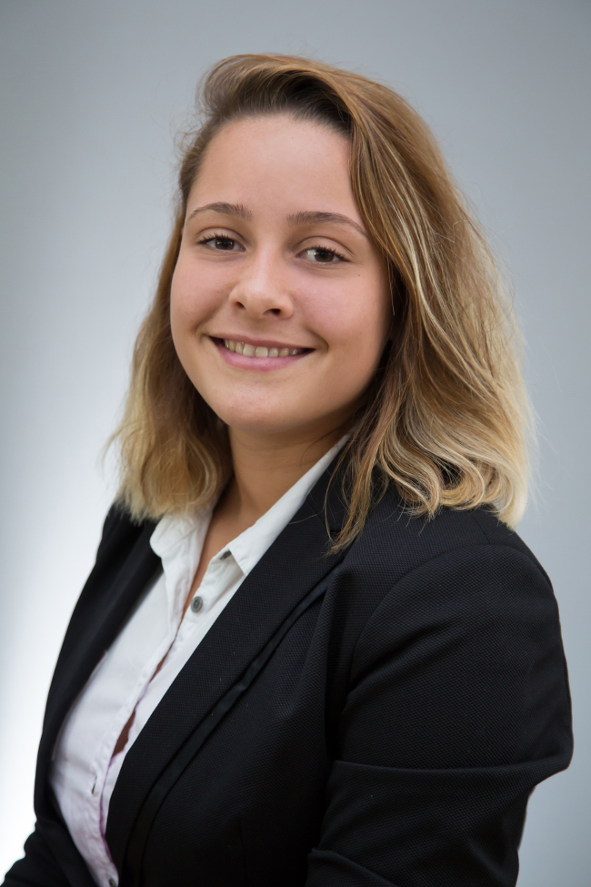 Fair haired young woman in business suit.